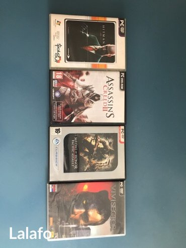 4 original igrice za pc! 1. Assassians creed ii 2. Vivisector 3. Medal - Beograd