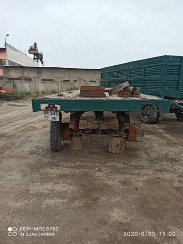 Прицепы - Кара-Балта: Продается прицеп КАМАЗ 10-ка платформа в хорошем состоянии. имеются