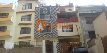 A flat system house having land area 0-3-3-3 of 3. 5 stories, facing in Kathmandu