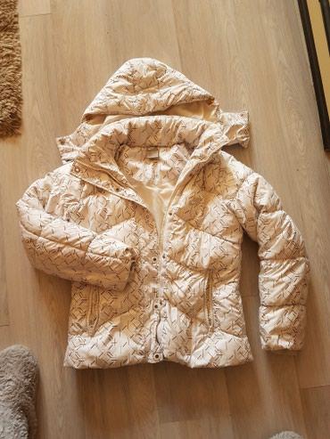 Nike jakna original,punjena je paperjem,bele boje bez ostecenja,vel - Nis