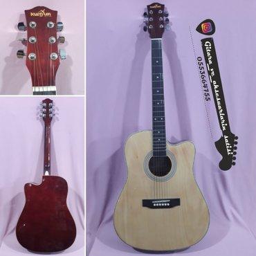 Bakı şəhərində Kunyun akustik gitara-- iri çanaq modeldi