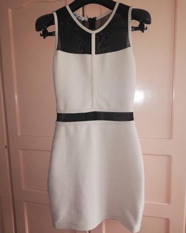 Haljina-svecana - Srbija: Haljina svecanaIzuzetno stoji, prijanja uz telo, prelep model.Jednom