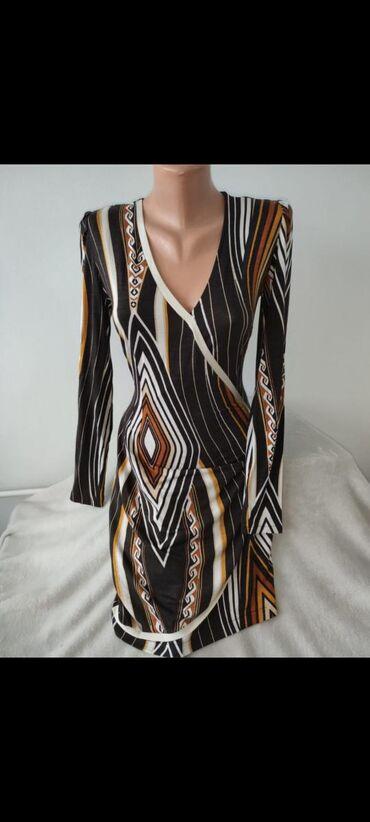 Elegantna haljina istice oblineRamena: 35cmRukav: 61cmGrudi