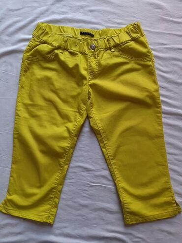 """Sisley - Srbija: Ženski šorc žute boje, marke """"Sisley"""". Veličina L, odlično očuvan"""