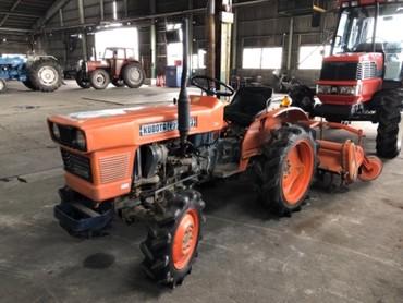 Продается надежный японский мини трактор KUBOTA L2201DT. Оснащен 3х