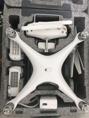 Квадрокоптеры - Кыргызстан: Продается дрон Dji Phantom 4 полный комплект.В