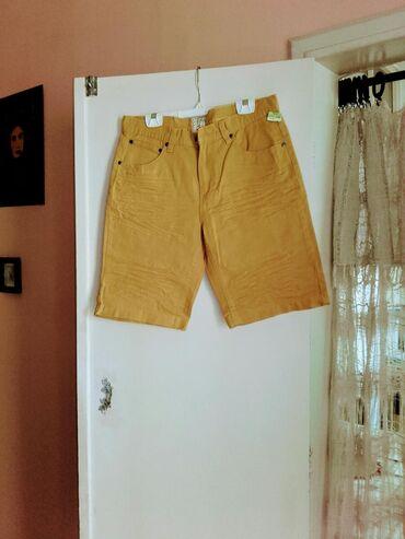 Zenske kape obim cm - Srbija: Zenske kratke pantalone - farmerke, 100% pamuk, Banglades.Duzina 55
