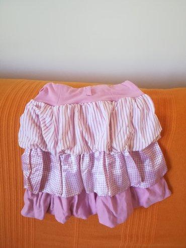 Suknja roze boje sa karnerićima vel 10, obim struka bez istezanja 46