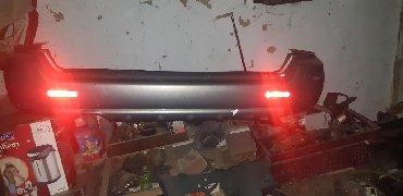 Задний бампер на субару ланкастер привозной не крашенный сост идеал