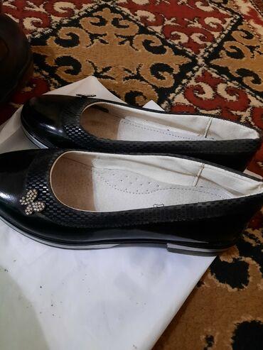 На 10 11 лет, чёрные туфли, для прогулок или для школы. Цена: 1000 сом