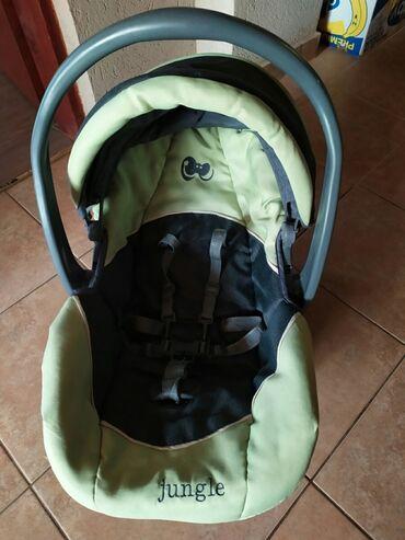 Za decu - Srbija: Ocuvana nosiljka za decu koja se montira na kolica ili auto
