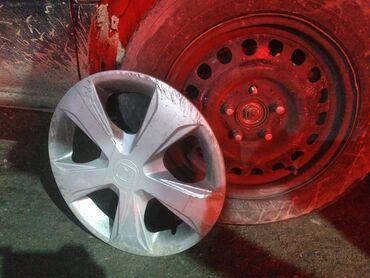 Продам железные диски вместе с колпаками без шин 15 размер 3диска от м