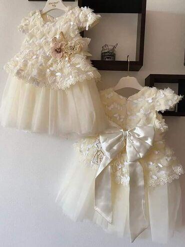 NOV MODELŠampanjac prelepa haljinica, od neznog satena,pet redova tila