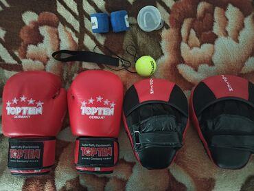 Спорт и хобби - Аламедин (ГЭС-2): Боксёрская перчатка:купил за 1000 продаю за 700 почти новая размер 12-