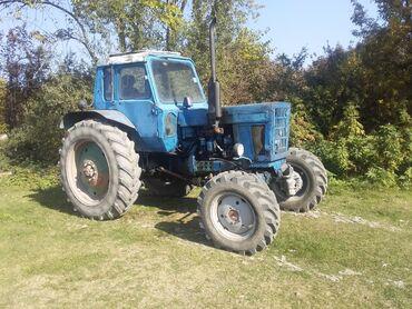Mtz 82 traktor saz veziyyetde üstünde kotan ve ot biçen verilir