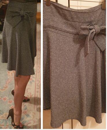 Siva suknja - Srbija: Poslovna suknja od tvida, siva melirana, volan, do kolena. Jako lepa
