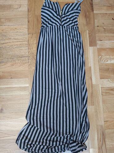 Duga haljina. Nova. Velicina univerzalna, ina umetke za grudi
