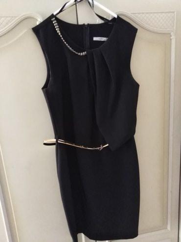 Ženska odeća | Boljevac: Svečana haljina. Crne boje sa zlatnim kaišem i ogrlica koja je na