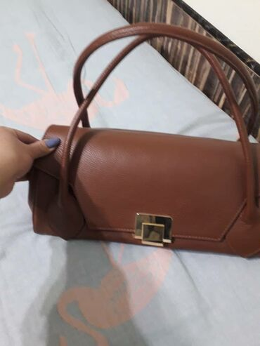 Новая кож.сумка очень удобная, вместительная, отлично качества, цвет