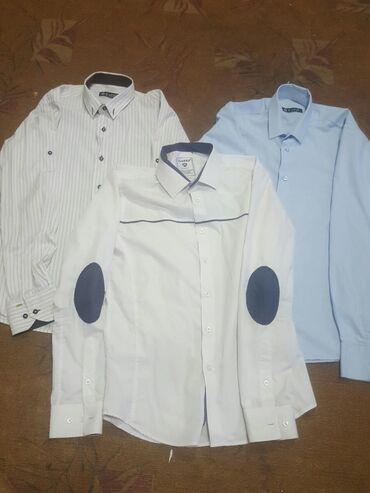 Рубашки подростковые в отличном состоянии. Каждая по 100с.размер s