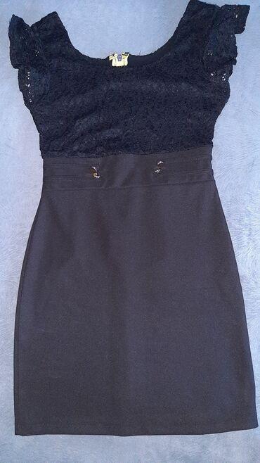Elegantna haljina,ocuvana,bez ostecenja. Velicina uni,odgovara za M