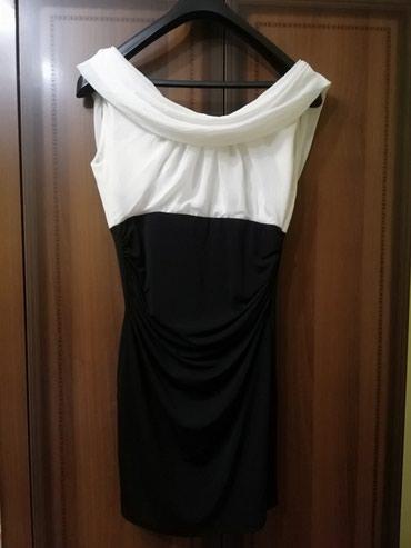 Haljine - Lajkovac: Elegantna haljina da volanom na ledjima u 40 broju