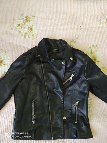 Продаю кожаную куртку черного цвета.Совсем новая носила 2.3