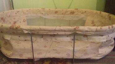 Подвесная люлька - качалка в кроватку. Крепится в кроватку за бортики