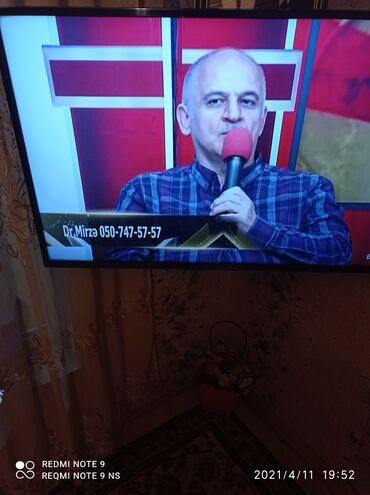 Televizor LG 81 dioqnal azişlənmiş hal hazırda evdə işlədilir