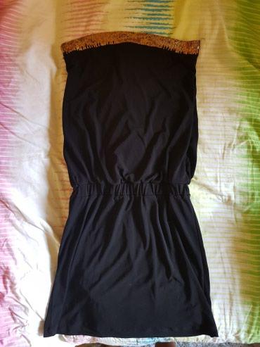 Ženska haljina pozadi ima tri mašnice prelepa za izlazak - Odzaci