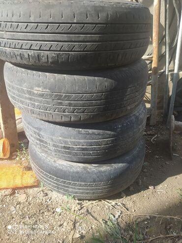 железные диски r14 в Кыргызстан: Продаю летние шины 185/75 r14 с железными дисками и колпаки Звоните
