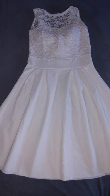 Elegantna bela haljinica,ocuvana,bez ostecenja,kao nova. Velicina