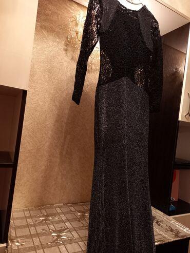 Платье вечернее 46-48 размер.Хорошее качество.Состояние