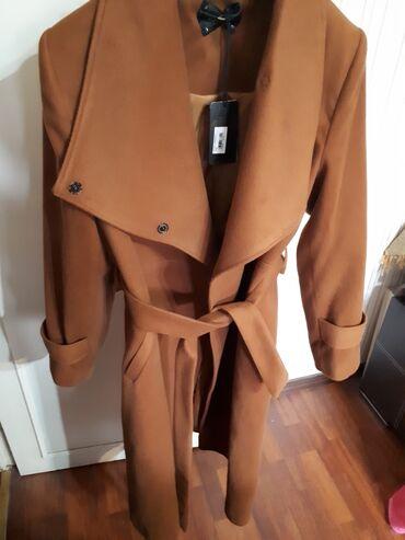 Пальто новое коричневое. Размер L. Высота 110см. Причина продажи: Не