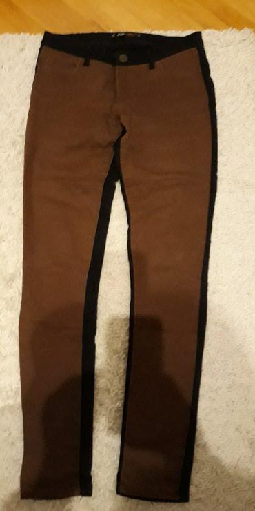 Crne pantalone uske - Srbija: Pantalone u dve boje napred su braon pozadi crne veoma lepo stoje uske