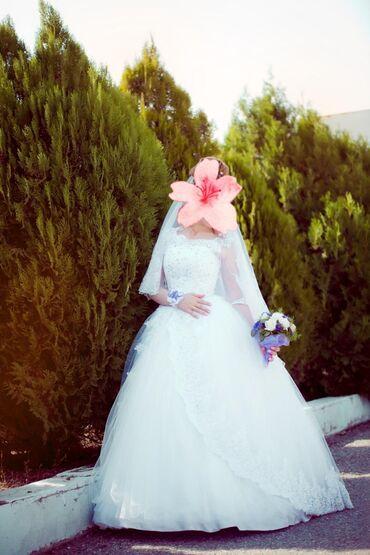 Продаю свадебное платье.надевалось всего один раз брали новым намного