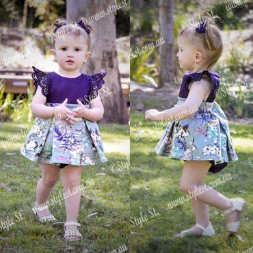 850din0-6m900din2-3godLila haljinica sa cvetnim motivom. Rukavi su