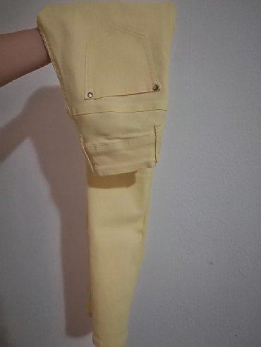 Pantalone zute - Srbija: Zute pantalone, velicina 38.Imaju elastina u sebi, prijatne su