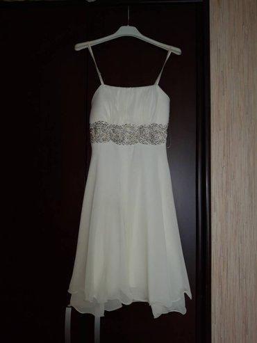 Haljine - Ub: Haljina sampanj boje, jednom nosena, veoma lepa, velicina 36, moguca
