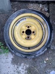 Запаска R15. Разболтовка 4*114,3. ЦО 66мм. Резина Dunlop 125/70/15 в Бишкек