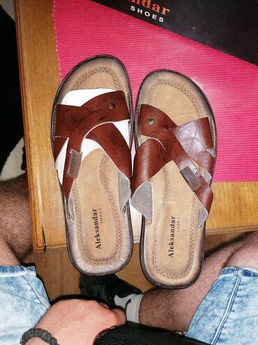 Potpuno nove kožne papuče, nikad obuveneBroj 41Veličina gazišta za