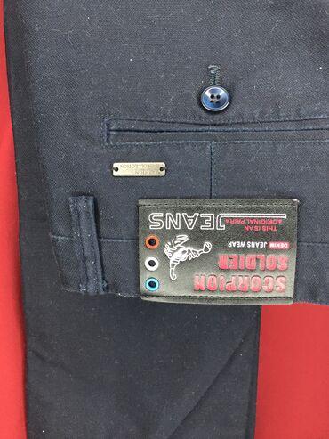 Новые брюки для мальчика темно-синего цвета в школу можно носить 10-12