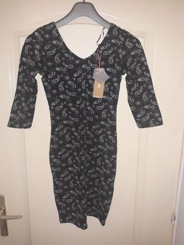 Uska crna haljina, potpuna nova, ima etiketu. Kupljena u radnji Tally - Belgrade