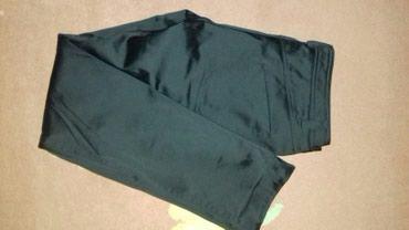 Satenske elegantne crne pantalone. Prava nogavica. Nisu nosene, samo - Jagodina