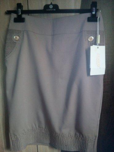Gəncə şəhərində Продам новую юбку,цвет бежевый,сзади молния и небольшой разрез,прямая