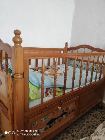 Детский мир - Кировское: Детская кроватка деревянная, с нижними шкафами для одежды, боковина и