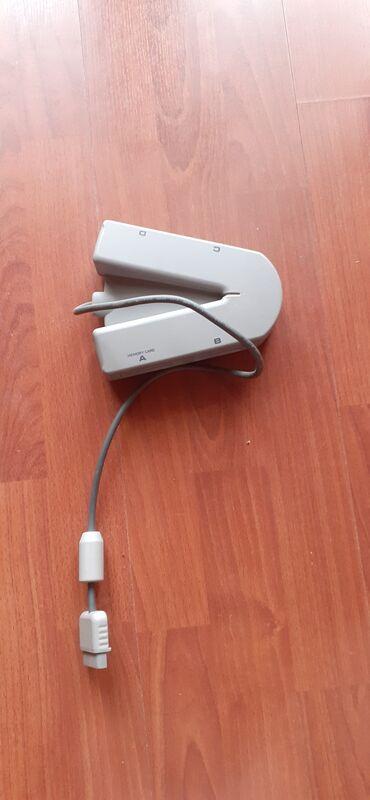 Elektronika - Zrenjanin: Priključak za 4 džojstika za PS Prodajem stvari iz svoje kuće koje mi