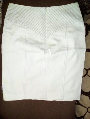 Kaput-vogeli - Srbija: Vogeli beli suknja. Ima postavu.Slabo nosena, tako da je bez