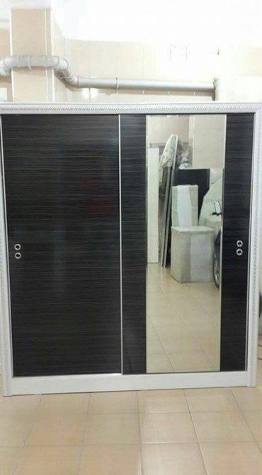 Bakı şəhərində Kupe dolab 160 eni 210 hündürlük 60 derınlık  Siyah qapılar ve beyaz r