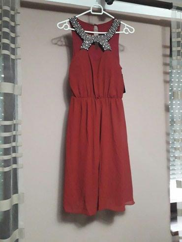 Dve svecane haljine u crnoj (nosena jednom) cena 1499 din i crvenoj - Belgrade